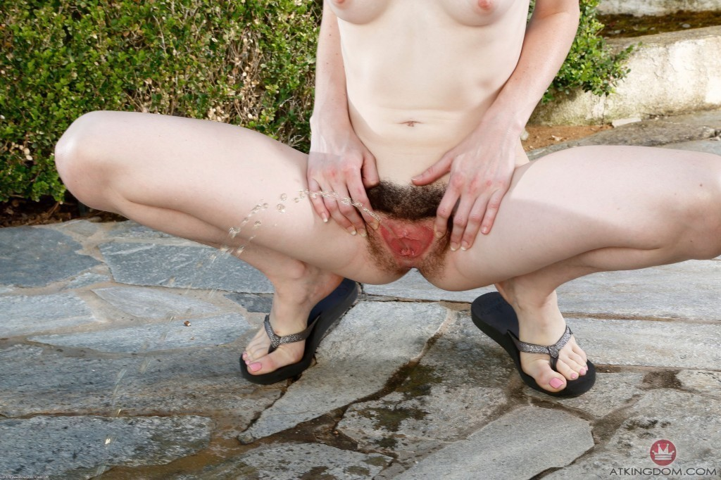 Pissing woman photo