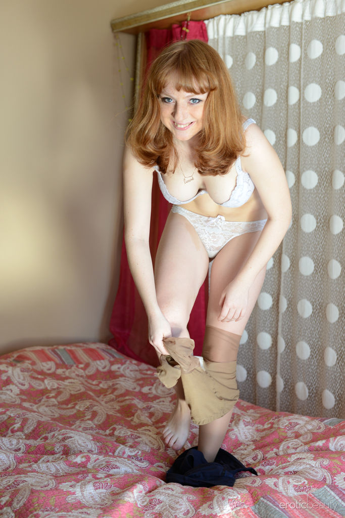 Nerdy redhead nude