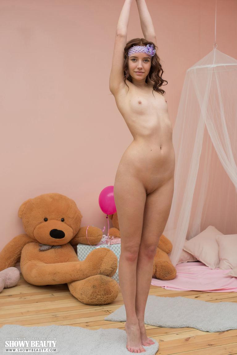 cute brunette teen posing with a teddy bear at brdteengal
