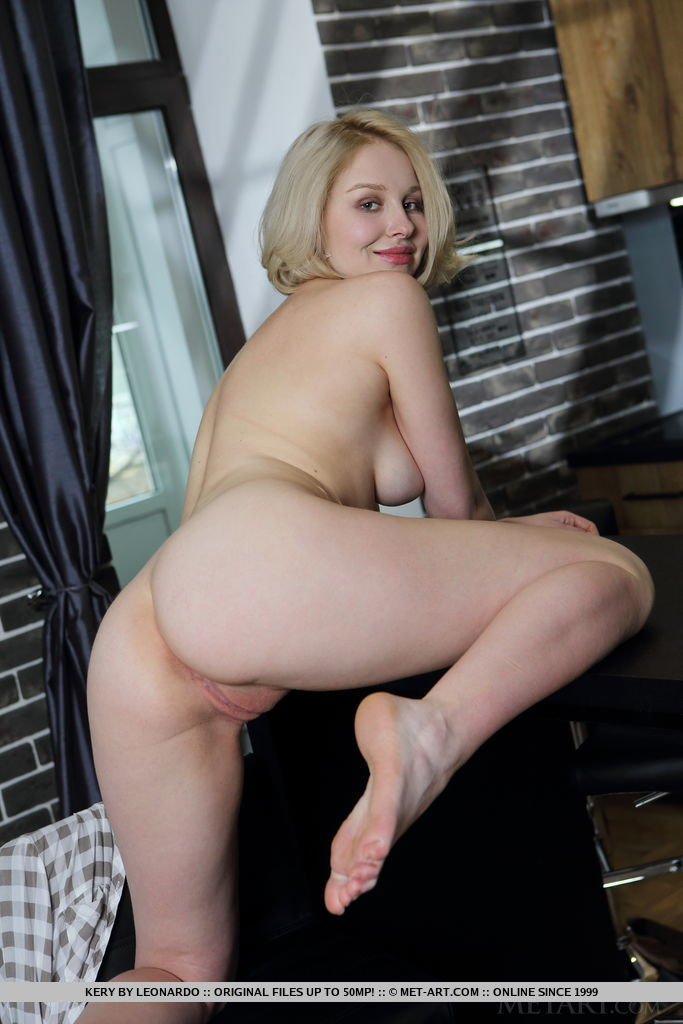 blonde with pale skin takes off her revealing dress at
