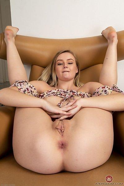Petite blonde Natalia Queen spreads her ass