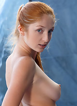 Gorgeous freckled redhead takes off her bikini