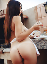 Busty brunette Niemira nude by a grill