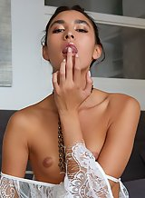 Flat-chested brunette fingering her shaved pussy