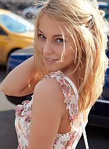 Shaved blonde girl takes off her dress