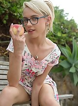 Upskirt shots of a nerdy blonde toying outdoors