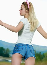 Shaved blonde with pale skin takes off her jean shorts