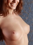 Brunette with big firm tits posing