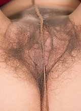 Hairy brunette takes off her pantyhose