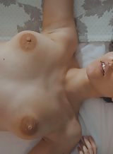 Hairy brunette with huge areolas spreading in bed