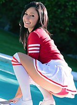 Cute sporty brunette nude by the pool