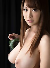 Gorgeous Asian girl with big tits stripping