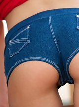 Cute brunette takes off her jean shorts to masturbate