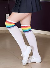 Flat-chested girl in striped socks and white cotton panties