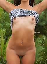 Shaved brunette with tan lines nude outdoors