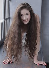 Long-haired brunette teen posing in long socks