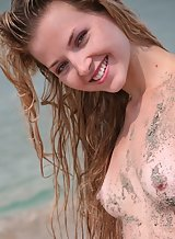 Shaved blonde nude in the sea