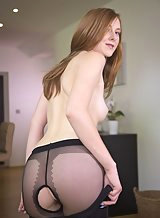 Freckled redhead takes off her crotchless pantyhose