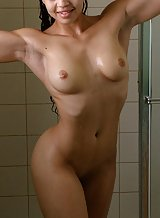 Muscular girl showering
