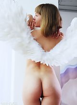 Shaved redhead teen with angel wings