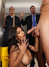 Busty chick seduces a business man in the company's elevator