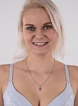 Casting pics of a green-eyed blonde amateur with large areolas