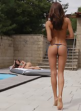 Horny lesbians licking each other by the pool