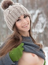 Brunette teen with long hair pulls her panties aside in the snow