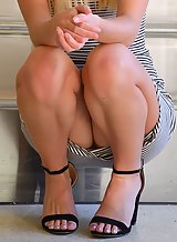 Upskirt pics of a shaved blonde with tan lines