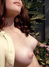 Freckled redhead with puffy nipples posing nude