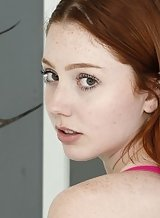Freckled redhead amateur spreads her holes