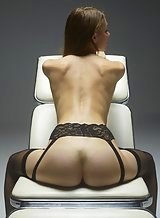 Brunette in lingerie posing on a chair