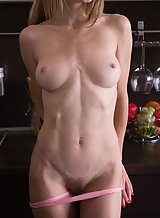 Skinny hairy blonde with small nipples spreading in the kitchen