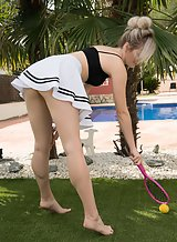 Shaved blonde tennis player takes off her skirt