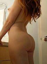 Hairy redhead amateur posing nude in bed