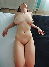 Brunette with big natural boobs nude in bed