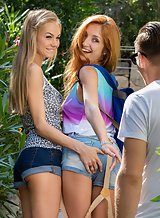 Gorgeous lesbian babes Michelle and Nancy licking each other in front of a guy