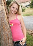 Blonde teen toying outdoors