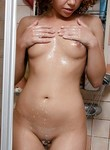 Redhead toying in the shower