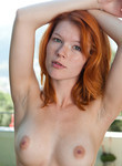 Stunning natural redhead posing naked outdoors
