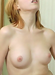 Pale-skinned redhead rubbing her hairy pussy