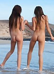 3 girls posing nude at the beach