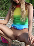Cute teen in a colorful bathing suit