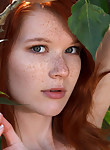Shaved freckled redhead nude in a creek
