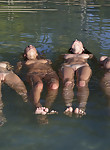 4 girls nude in the sea