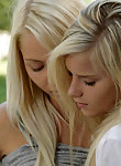 Blonde lesbians licking each other in a park