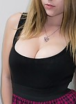 Nerdy busty girl flahes her insane cleavage in a library