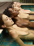 4 girls nude in a pool