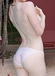 Redhead with pale skin in a pool