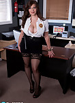 Busty brunette security agent shows off her huge tits